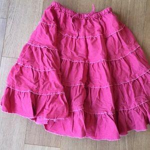 Mini Boden girl's coral skirt. Size 5-6